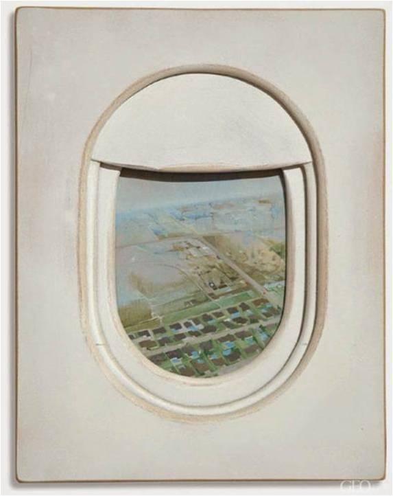 用飞机窗户突破自然摄影