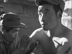 """志愿军战俘被刺字""""反共抗俄""""并送往台湾"""