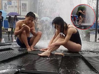 实拍小情侣在广场喷泉下当众洗澡10多分钟
