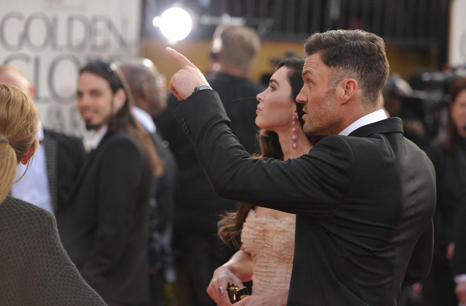 当地时间2013年1月13日,美国比弗利山庄,第70届金球奖(the 70th Annual Golden Globe Awards)颁奖典礼举行,众星亮相红毯。图为梅根-福克斯和老公布莱恩亮相。
