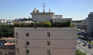 """北京一大厦楼顶建""""空中花园"""" 种植树木蔬菜"""