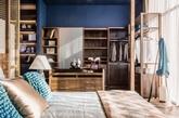 So En Lim设计的马来西亚Waa! Design & Culture展厅,生活化的展示空间,温馨优雅。这就是最近流行的闷骚蓝和 逼格灰的完美结合。精巧的摆件和室内大片的绿植是内部的两点,中国式的屏风设计和质朴的木质家居展示的是亚洲风格。灯具和座椅是西式设计,中西风格在这里完美融合和演绎。
