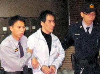 """连胜文枪击案嫌犯""""马面""""林正伟(中)。图片来源:台湾《联合报》"""