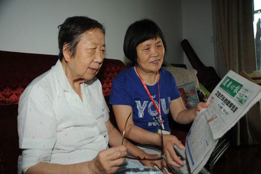 """在日前举办的社区""""老伙伴""""志愿者培训班上,一名志愿者提议:在同楼住的"""