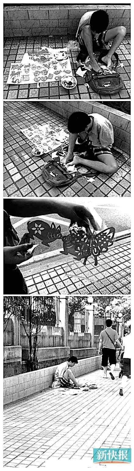 广州:无臂男孩用脚剪纸谋生(图)