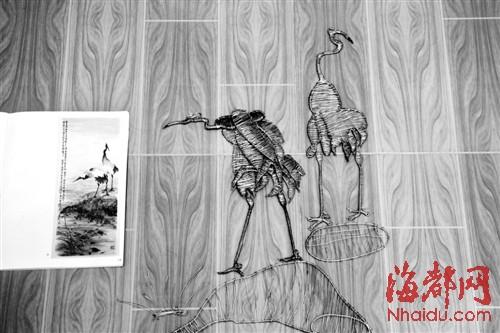 用铁丝『画』的《白鹤图》