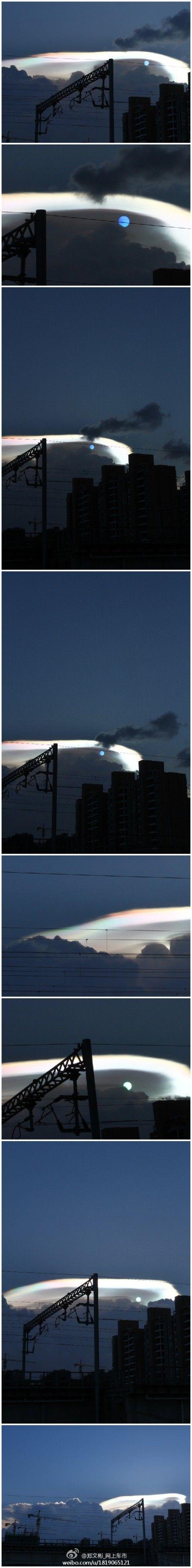 """网友""""郑文彬_网上车市""""拍摄的太阳由蓝色变为绿色的过程和大片彩色云彩。"""